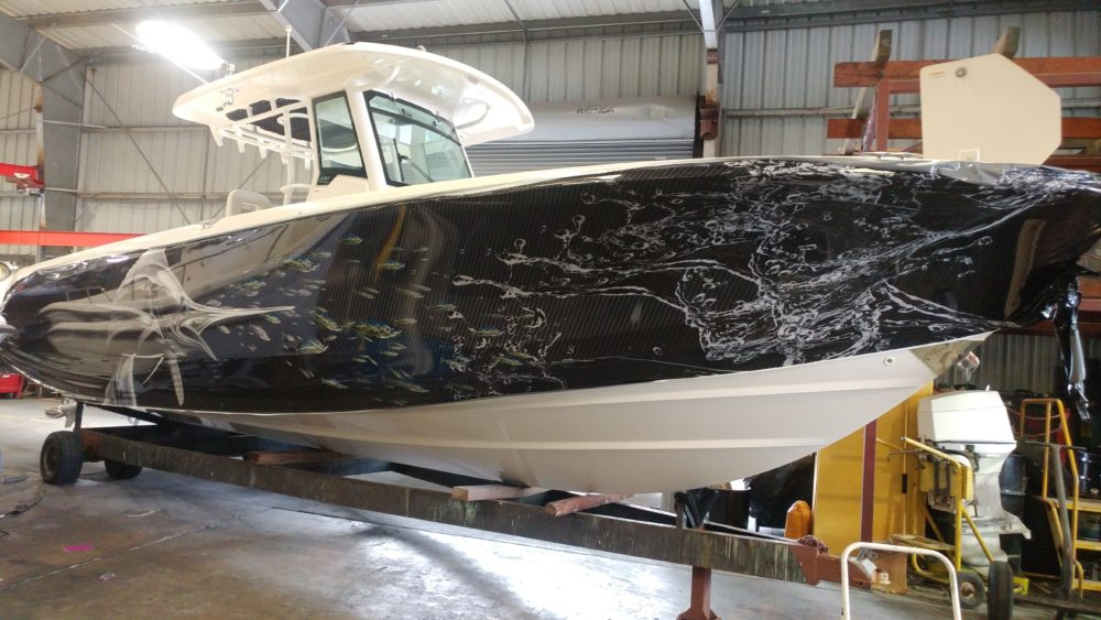 Boat wrap with graphics from artist Nick Hannan